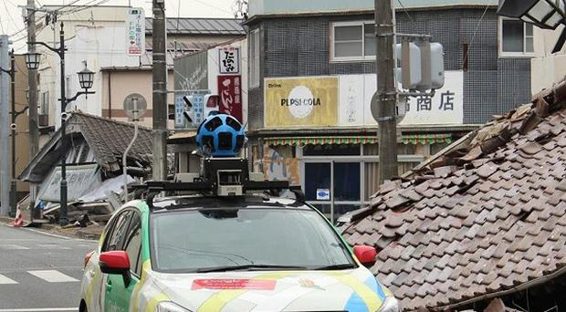 Google's camera-equipped vehicle moves through Namie town in Japan (AP/Google)