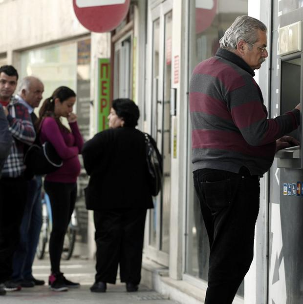People queue outside a bank in Cyprus (AP)