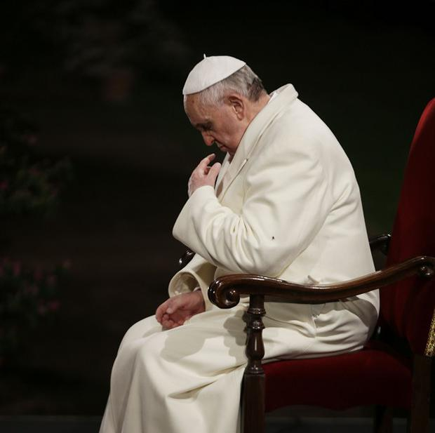 Pope Francis said the shroud 'speaks to our heart and moves us to climb the hill of Calvary' (AP)