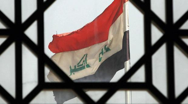 The attack in Tikrit, north of Baghdad, killed five Iraqi policemen