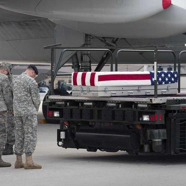 The coffin of the stabbed US soldier is returned home (AP)