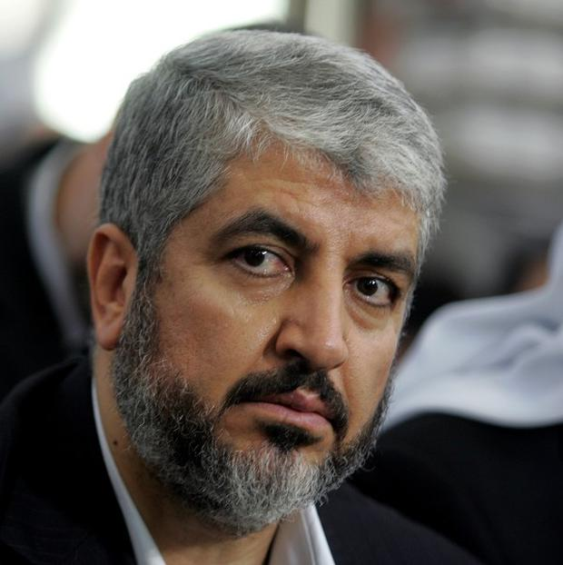 Khaled Mashaal has been re-elected as leader of Hamas (AP)