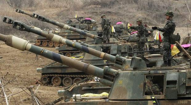 South Korean troops guard the border with the North (AP)