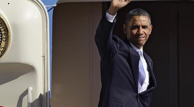 The cut from Barack Obama's salary amounts to 20,000 dollars (13,250 pounds) (AP)