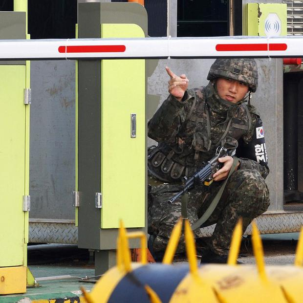 A South Korean army soldier gestures at a military checkpoint in Paju, South Korea, near the border village of Panmunjom (AP)