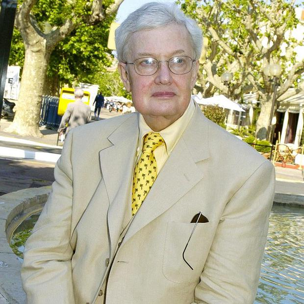 Roger Ebert was known for his thumbs-up, thumbs-down reviews (AP)