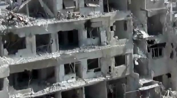 Wrecked buildings after heavy shelling in a Damascus suburb (AP/Shaam News Network)