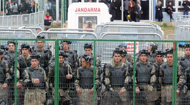 Turkish military police guard the court (AP)