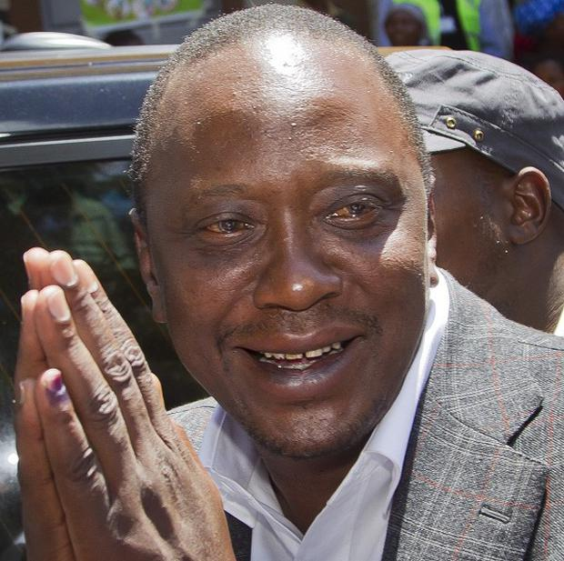 Uhuru Kenyatta is being sworn in as the new Kenyan president (AP)