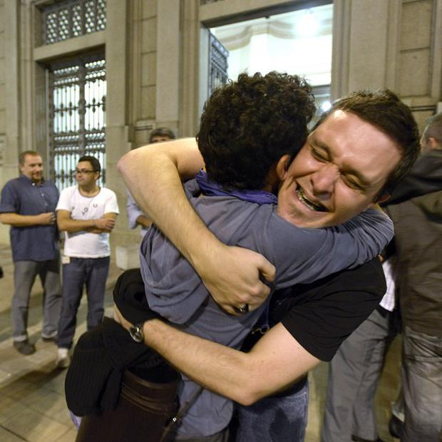 "People celebrateafter lawmakers passed the ""marriage equality project"" in Montevideo, Uruguay (AP)"