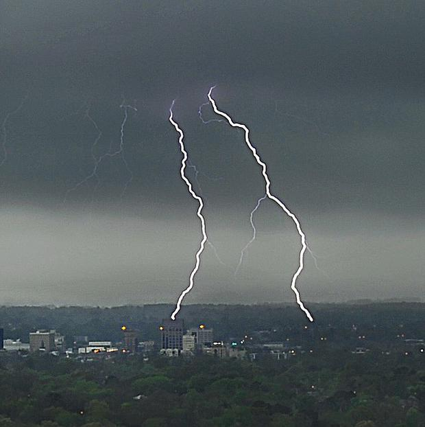 Lightning strikes above the city of Huntsville in Alabama (AP/ Bob Gathany)