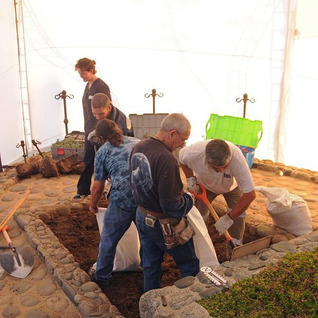 Forensic specialists dig at the grave of Nobel laureate Pablo Neruda in Isla Negra, Chile (AP/Judiciary of Chile)