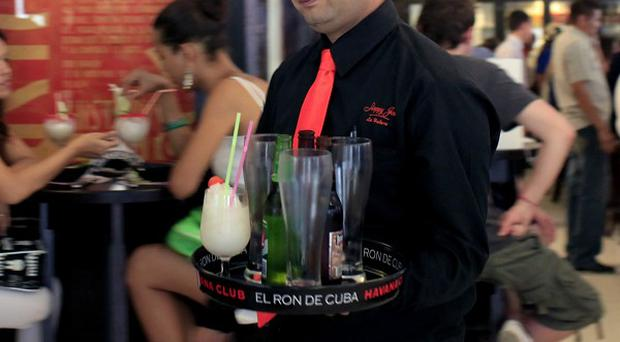 A waiter serves drinks at Sloppy Joe's Bar during its reopening in Havana, Cuba (AP/Franklin Reyes)