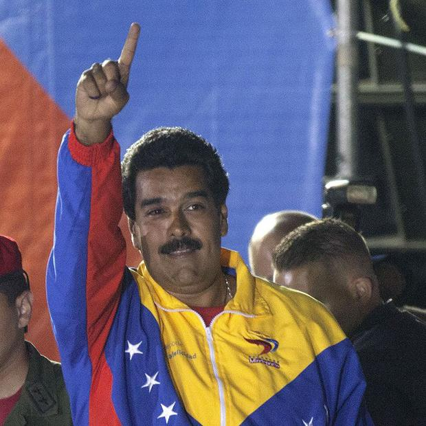 Venezuela's newly elected president Nicolas Maduro celebrates his victory after official results are announced (AP/Ramon Espinosa)