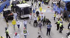 Police clear the area at the finish line of the 2013 Boston Marathon (AP)