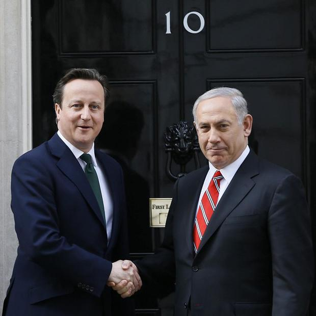 David Cameron greets the Prime Minister of Israel, Benjamin Netanyahu, at Downing Street (AP)