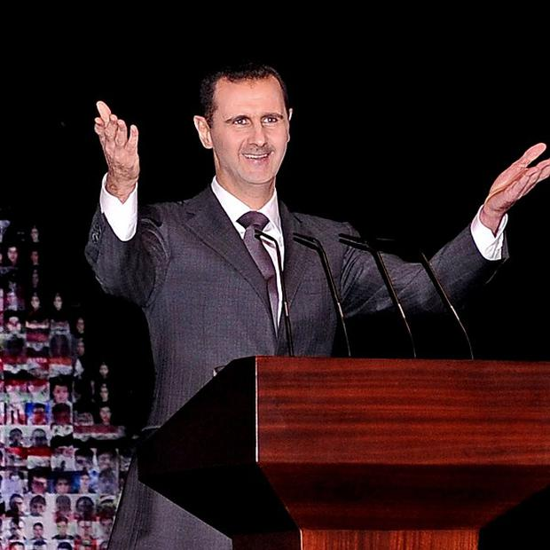 Syrian President Bashar Assad's government is suspected of having used chemical weapons (Sana/AP)