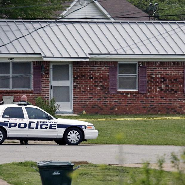 A police car blocks access to a house in Corinth, Mississippi, after officers investigating the ricin letters arrrested Paul Kevin Curtis (AP)