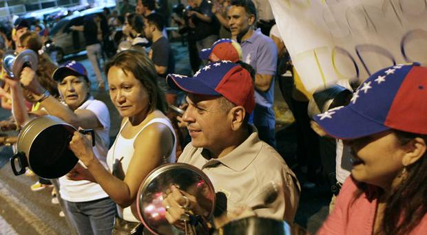 Opposition supporters protest against the results of the presidential election in Caracas, Venezuela (AP)