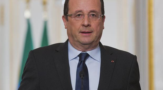 French President Francois Hollande said his government is not changing the principle that France does not pay ransoms (AP)