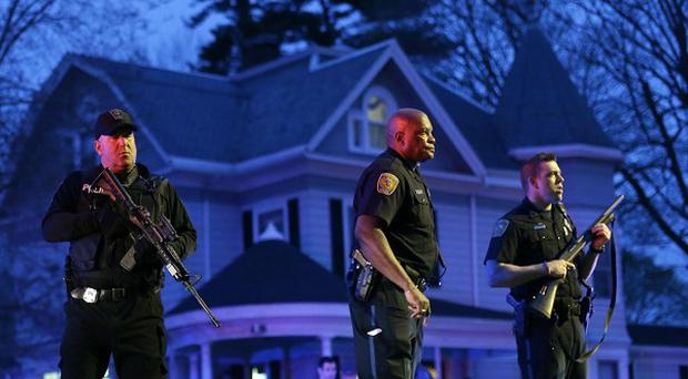 A huge police presence was on view during the search for the suspect in the Boston Marathon bombings in Watertown, Massachusetts (AP)