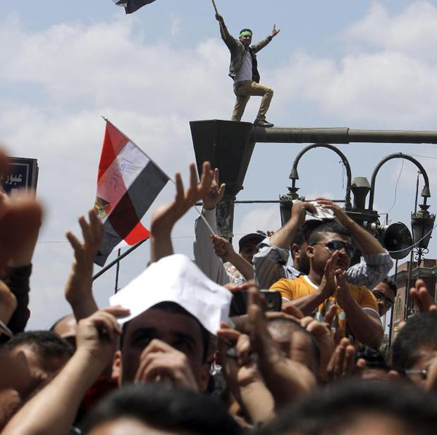 Supporters of Egypt's Islamist president claim that the judiciary is controlled by supporters of ousted President Hosni Mubarak (AP)