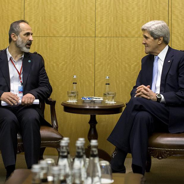 US Secretary of State John Kerry met with Syrian opposition leader Moaz al-Khatib in Istanbul on Saturday (AP)