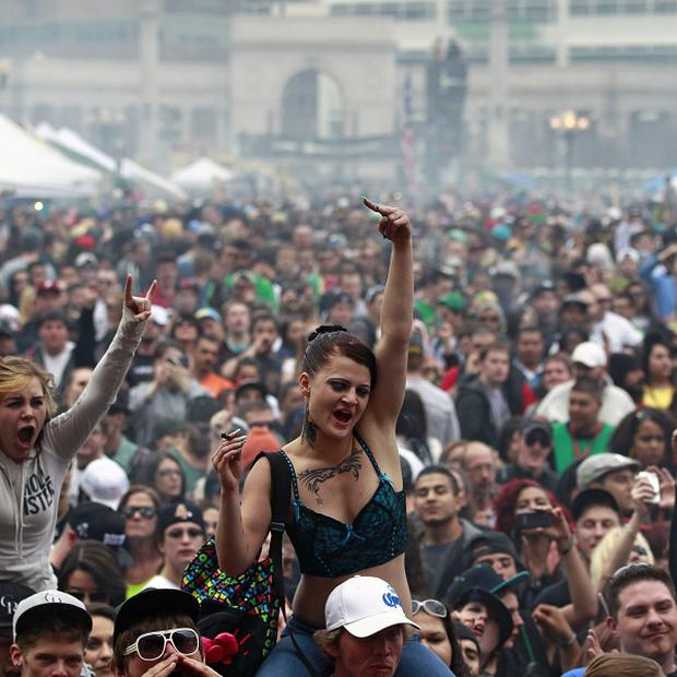 Tens of thousands of people gathered to smoke marijuana in Denver (AP)