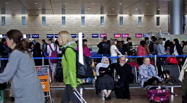 Passengers wait in a departure hall at the Ben Gurion airport near Tel Aviv, Israel, as the country's three airlines went on strike (AP)