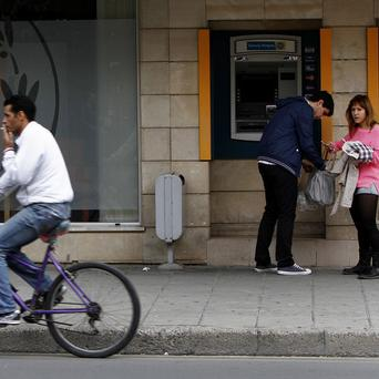 A cashpoint outside a branch of the Bank of Cyprus in Nicosia (AP)