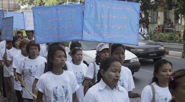 Activists at the Union Peace Rally in Rangoon, Burma, carry placards that read