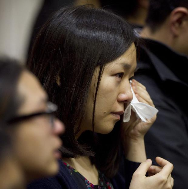 A member of the audience sheds tears during Lu Lingzi's eulogy at Metcalf Hall in Boston University (AP/The Boston Globe, Dina Rudick)