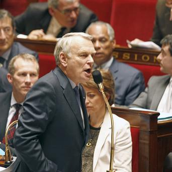 French prime minister Jean-Marc Ayrault addresses members of parliament during the debate on gay marriage (AP Photo)