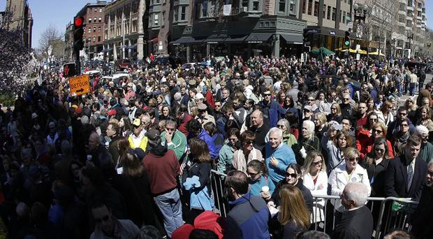 People attend an interfaith service held near a makeshift memorial on Boylston Street, near the finish line of the Boston Marathon (AP)