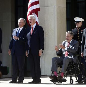 President Barack Obama stands with, from second from left, former presidents George W Bush, Bill Clinton, George H W Bush, and Jimmy Carter at the dedication of the George W Bush presidential library (AP)