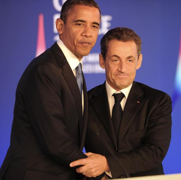 Barack Obama and Nicolas Sarkozy hold a joint press conference ahead of the start of the G20 summit in 2011