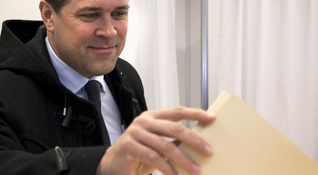 Chairman of the Independence Party Bjarni Benediktsson casts his ballot (AP/Brynjar Gauti)