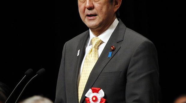 Japanese Prime Minister Shinzo Abe is shifting to a more conservative agenda (AP)