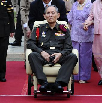 Thai King Bhumibol Adulyadej had a high temperature and slight cough (AP)