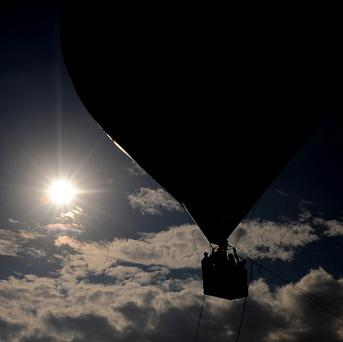 A hot-air balloon's pilot and another man remain missing after it fell into the Pacifc Ocean