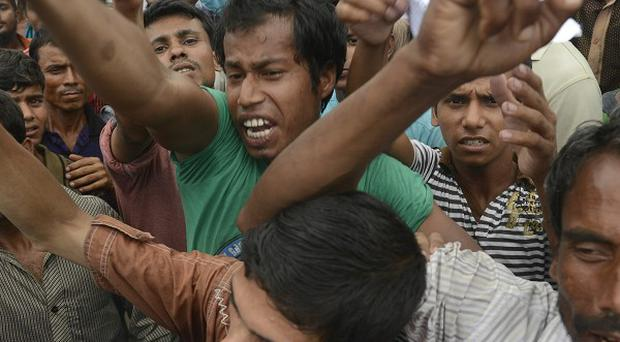 Protestors gather on the streets to demand for justice to those who were killed when a building collapsed in Savar, Bangladesh (AP)