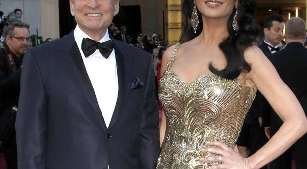 Catherine Zeta-Jones and husband Michael Douglas (AP)