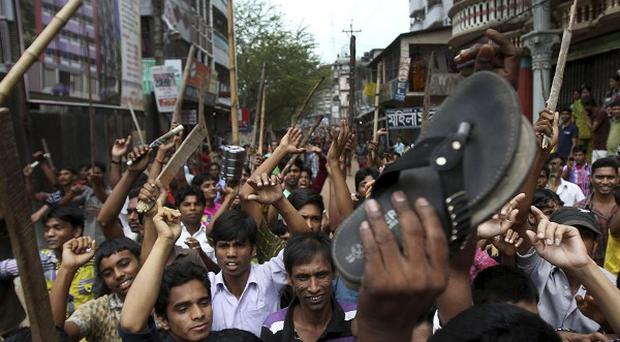 Protestors demand the death penalty for those responsible for the collapse of a garment factory building that killed hundreds in Savar, near Dhaka (AP)