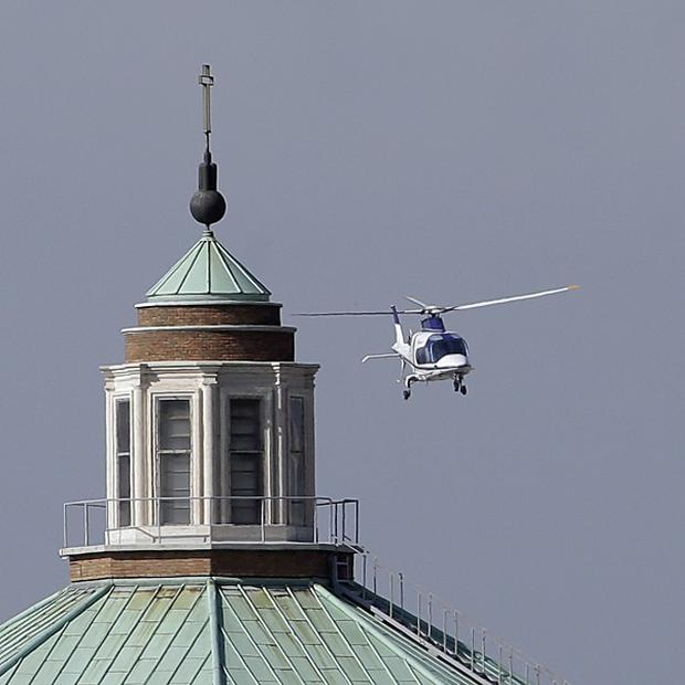 The helicopter carrying back Pope emeritus Benedict XVI from the pontifical summer residence of Castel Gandolfo, lands at the Vatican helipad (AP)