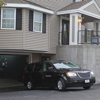 A vehicle believed to be carrying the body of Tamerlan Tsarnaev backs into an underground garage at the Dyer-Lake Funeral Home (AP)