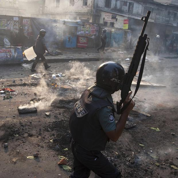 A policeman walks on a street in Dhaka during a protest by Islamic activists (AP)