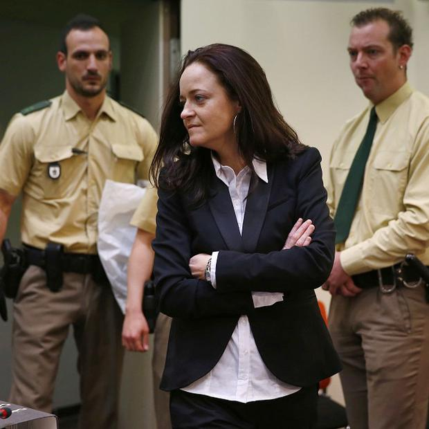 Beate Zschaepe, of the neo-Nazi group National Socialist Underground enters the court room before the start of her trial in Munich (AP)