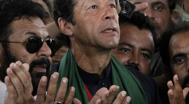 Imran Khan, Pakistan's cricket star-turned-politician, has been injured in a fall (AP)