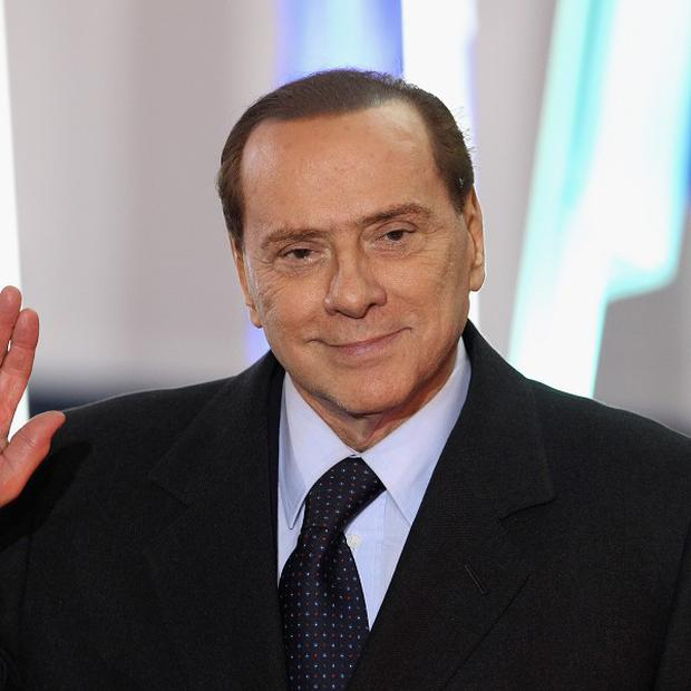 Silvio Berlusconi claims charges against him are politically motivated