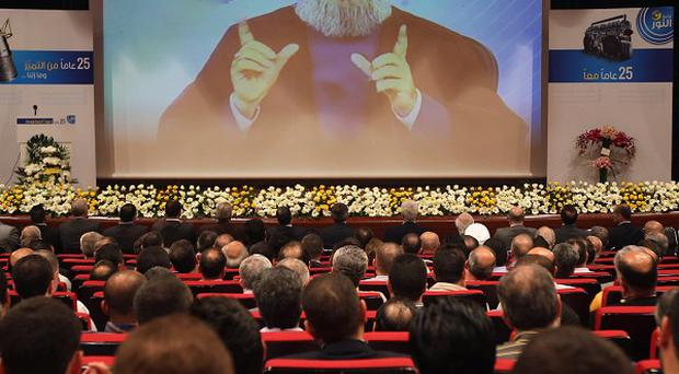 Hezbollah leader Sheik Hassan Nasrallah speaks via video during a conference in Beirut (AP)